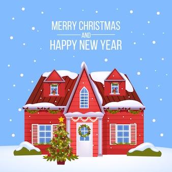Cartão postal de inverno de férias de natal e ano novo 2021 com a tradicional construção vermelha, árvore de natal decorada, neve. fundo festivo com fachada de casa. cartão postal exterior da arquitetura do feriado de natal
