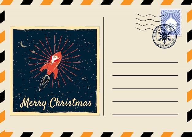 Cartão postal de natal e ano novo com selos e marca retrô. foguete de papai noel