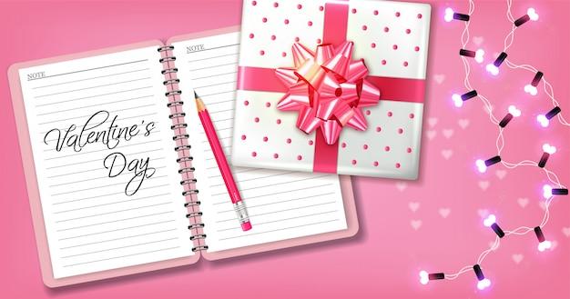 Cartão romântico rosa com caixa de presente e guirlanda