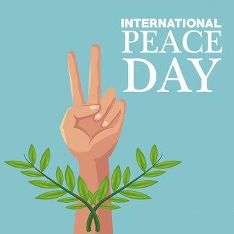 Cartaz de cores símbolo da vitória da mão e ramos de oliveira cruzou o dia internacional da paz