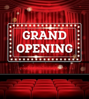 Cartaz de inauguração com luzes de néon em um teatro