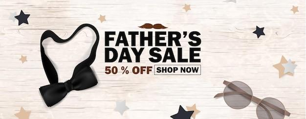 Cartaz de promoção de venda de dia dos pais ou banner, mídia social, design de marketing com gravata borboleta preta, óculos com fundo de madeira. promoção e modelo de compra para o dia dos pais.