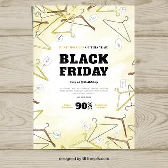 Cartaz de sexta-feira preta com cabides de roupas
