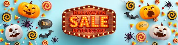 Cartaz de venda de halloween e modelo de banner com uma linda abóbora de halloween e doces
