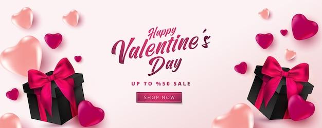 Cartaz de venda do dia dos namorados ou banner com corações e caixa de presente realista em fundo rosa suave.