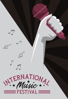 Cartaz do festival de música internacional com microfone de levantamento de mão em fundo cinza