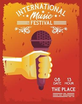 Cartaz do festival de música internacional com microfone de levantamento de mão em fundo laranja