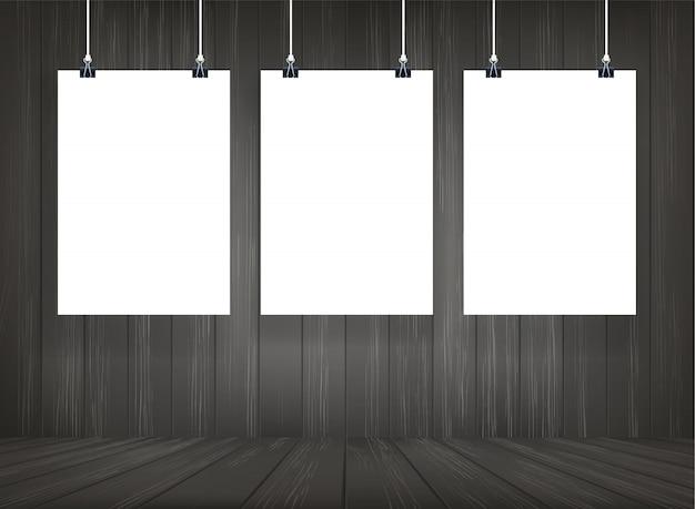 Cartaz do livro branco que pendura com fundo de madeira do espaço da sala.
