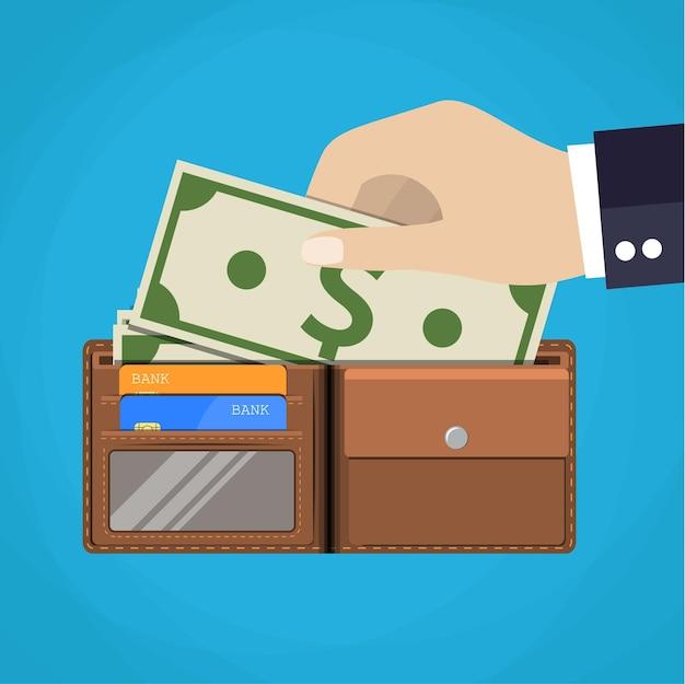 Carteira de couro com alguns dólares e cartões de crédito.