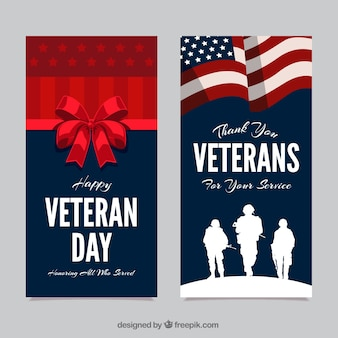 Cartões com silhuetas dos soldados e um laço vermelho