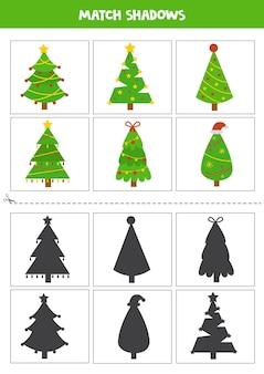 Cartões de correspondência de sombra para crianças em idade pré-escolar. árvores de natal fofas.
