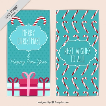 Cartões de natal com presentes e bastões de doces