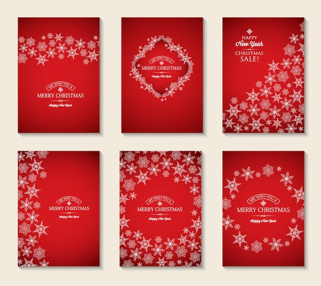 Cartões de natal e ano novo com inscrições e flocos de neve elegantes em vermelho