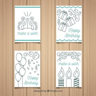 Cartões de quatro aniversários em design plano