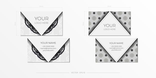 Cartões de visita brancos com padrões vintage. design de cartão de visita com ornamento de monograma.