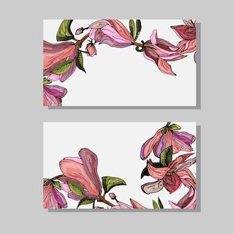 Cartões de visita com magnólias rosa florescendocartões florais decorativos em um fundo branco