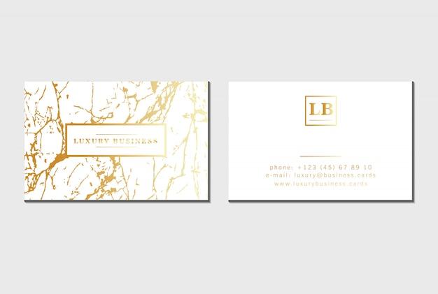 Cartões de visita de luxo dourado com textura de mármore, detalhes de folha de ouro.