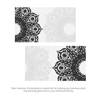 Cartões de visita de vetor com ornamentos gregos. modelo de vetor para design de impressão de cartões de visita cor branca com ornamento vintage preto.