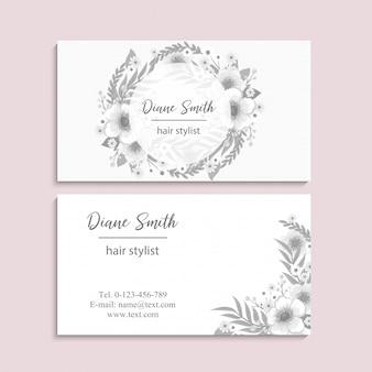 Cartões de visitas da flor brancos e pretos