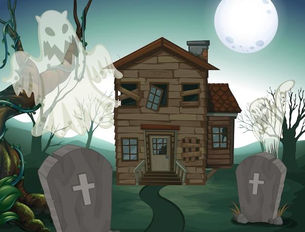 Casa assombrada e cemitério à noite