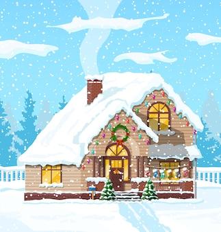 Casa coberta de neve com tema de natal