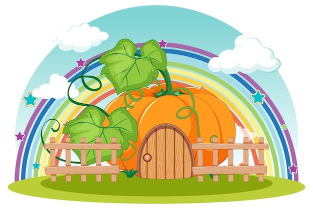 Casa de abóbora com arco-íris no céu