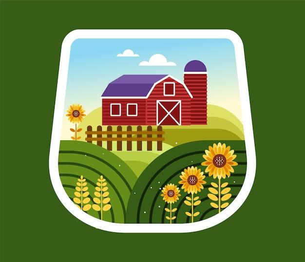 Casa de fazenda e campo de girassol