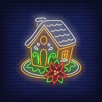 Casa de gengibre com poinsétia em estilo neon