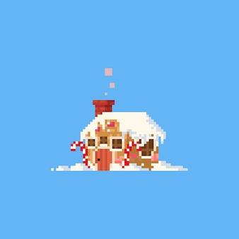 Casa de gengibre de pixel com neve