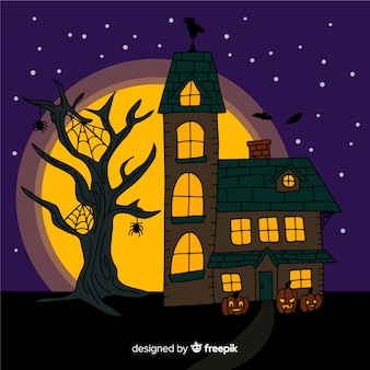 Casa de halloween em uma noite de lua cheia