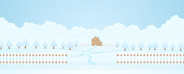 Casa de paisagem de inverno e árvores na colina com grama caindo neve e fundo de nuvem de cerca
