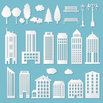Casa de papel. origami branco corta prédios de papelão com silhuetas de sombras da cidade cortada em papel.