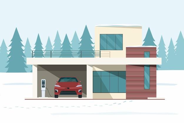 Casa moderna e carro elétrico em carga na paisagem de floresta de neve de inverno