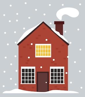 Casa sueca no inverno ... casa de tijolo vermelho norueguês na neve.