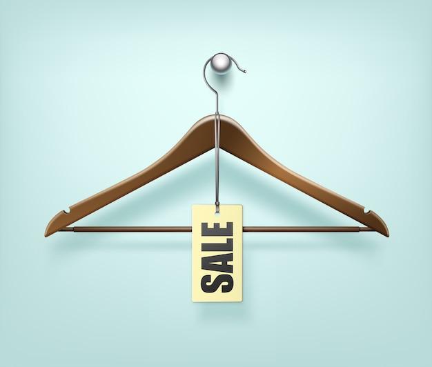 Casaco de roupas cabide de madeira com etiqueta de venda Vetor Premium