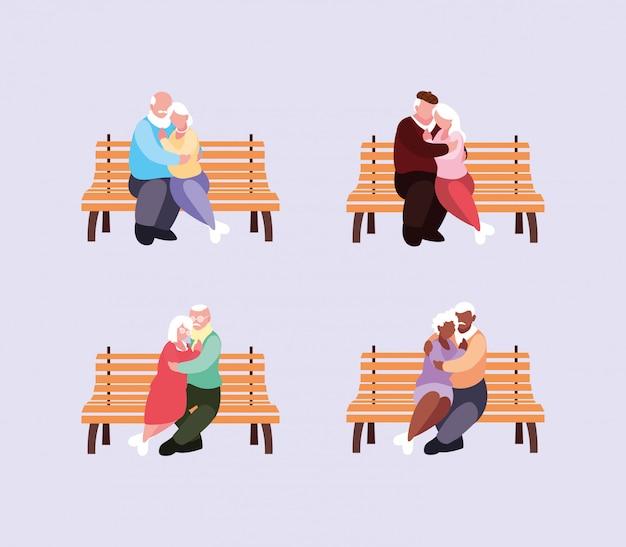 Casais de idosos sentados em cadeiras de parque