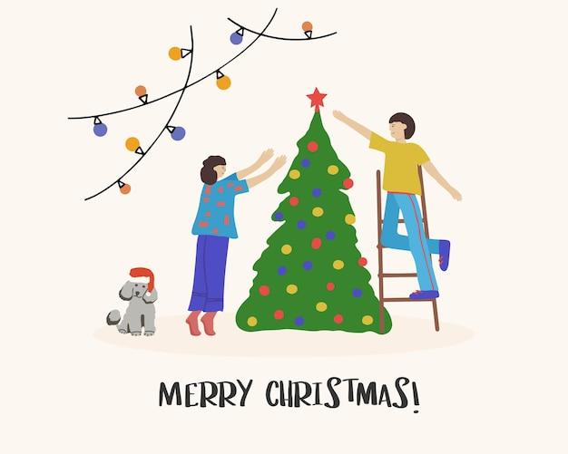 Casais felizes, rapazes e moças, decorando a árvore de natal