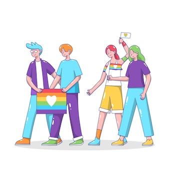 Casais segurando bandeiras do dia do orgulho