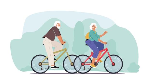 Casal adorável de idosos alegres andando de bicicleta