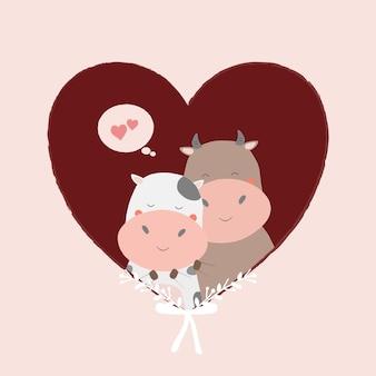 Casal adorável vaca dentro de um objeto isolado de coração.