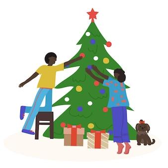 Casal afro-americano feliz decorando a árvore de natal