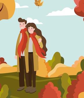 Casal andando com roupa de outono no acampamento