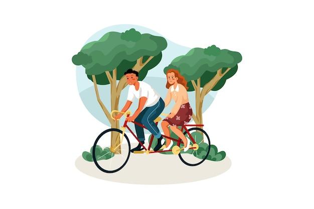 Casal andando de bicicleta dupla no parque