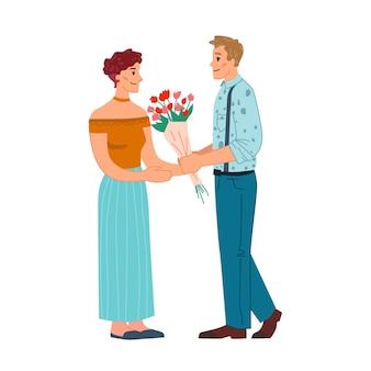 Casal apaixonado apresenta buquê de flores