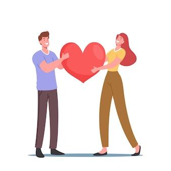 Casal apaixonado compartilha amor, segurando um enorme coração vermelho nas mãos. relações humanas, amor, namoro romântico. casal recém-casado