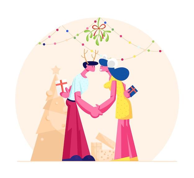 Casal apaixonado feliz beijando e segurando as mãos sob o galho de visco. ilustração plana dos desenhos animados