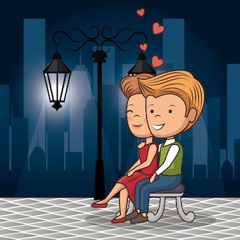 Casal apaixonado na rua à noite