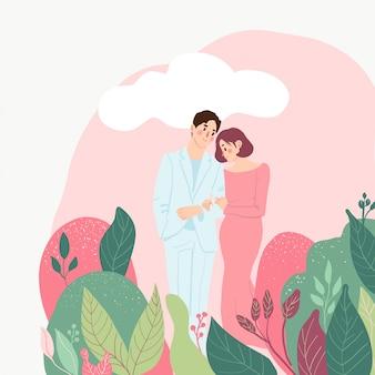 Casal apaixonado, rodeado de folhas