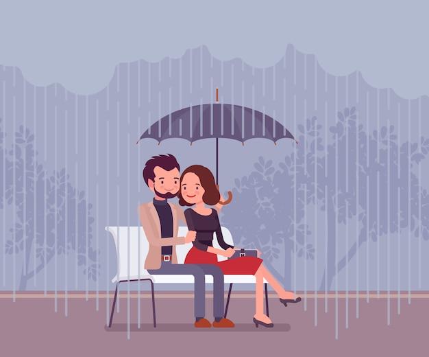 Casal apaixonado sob o guarda-chuva