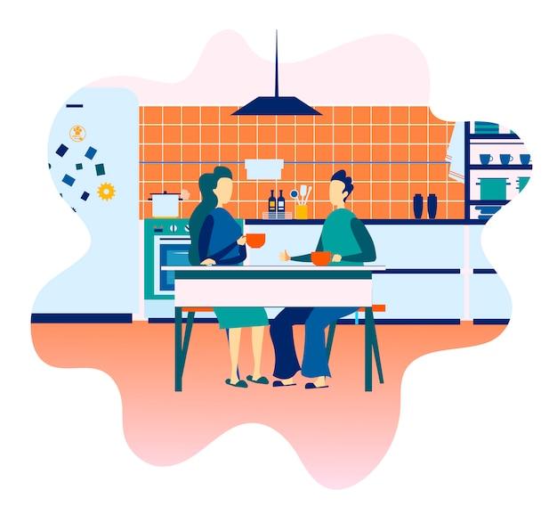 Casal bebendo café na cozinha, tendo o cartão de descanso